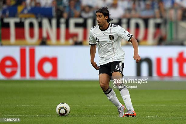 Sami Khedira of Germany runs with the ball during the international friendly match between Germany and Bosnia-Herzegovina at Commerzbank Arena on...