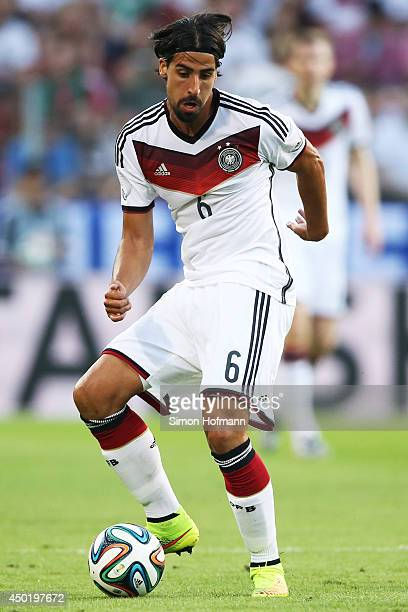 Sami Khedira of Germany runs with the ball during the International Friendly match between Germany and Armenia at Coface Arena on June 6 2014 in...
