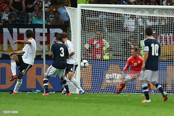 Sami Khedira of Germany scores an own goal against goalkeeper MarcAndre ter Stegen during the international friendly match between Germany and...