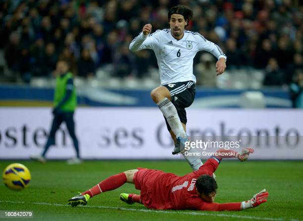 Sami Khedira of Germany scores his team's second goal during the international friendly match between France and Germany at Stade de France on...