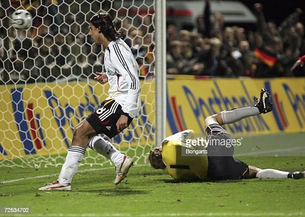 Sami Khedira of Germany scores to lead 3:1 against Marco Knaller, goalkeeper of Austria, during the Men's U20 international friendly match between...