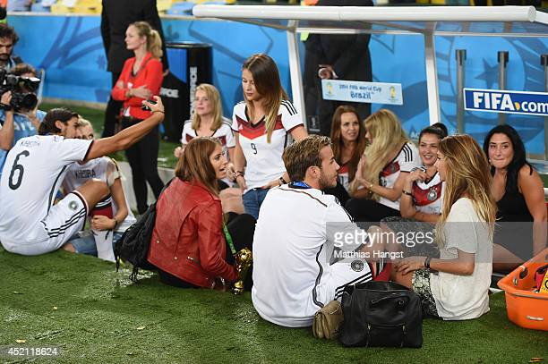 Sami Khedira of Germany takes a picture with girlfriend Lena Gercke as Cathy Fischer girlfriend of Mats Hummels of Germany Montana Yorke girlfriend...