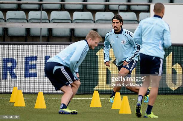 Sami Khedira of Germany warms up during a training session ahead of the FIFA 2014 World Cup Qualifier match between Faroe Islands and Germany on...