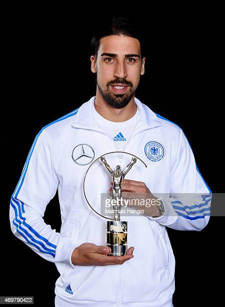 Sami Khedira of Germany winners of the Laureus World Team of the Year 2015 poses with the award at the Villa Kennedy hotel on March 23 2015 in...
