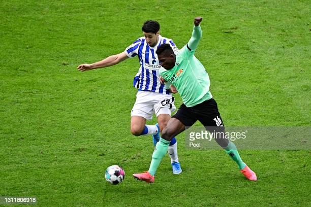 Sami Khedira of Hertha Berlin battles for possession with Breel Embolo of Borussia Moenchengladbach during the Bundesliga match between Hertha BSC...