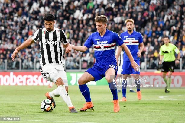 Sami Khedira of Juventus and Dennis Praet of Sampdoria in action during the serie A match between Juventus and UC Sampdoria at Allianz Stadium on...