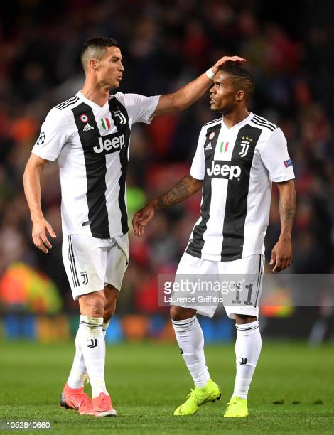 Sami Khedira of Juventus and Douglas Costa of Juventus celebrate following their sides victory in the Group H match of the UEFA Champions League...