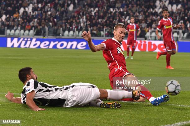 Sami Khedira of Juventus and Salamon Bartosz of Spal compete for the ball during the Serie A match between Juventus and Spal on October 25 2017 in...