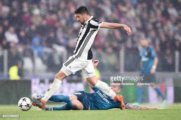 Sami Khedira of Juventus and Toni Kroos of Real Madrid in action during the UEFA Champions League Quarter Final Leg One match between Juventus and...