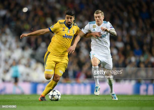 Sami Khedira of Juventus and Toni Kross of Real Madrid compete for the ball during the UEFA Champions League Quarter Final Second Leg match between...
