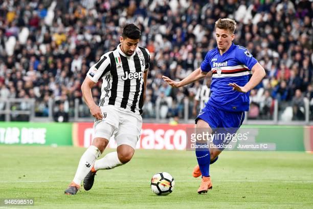 Sami Khedira of Juventus competes for the ball with Dennis Praet of UC Sampdoria during the serie A match between Juventus and UC Sampdoria at...