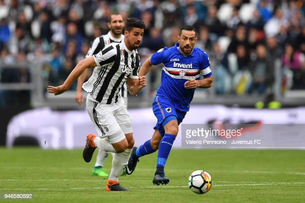 Sami Khedira of Juventus competes for the ball with Fabio Quagliarella of UC Sampdoria during the serie A match between Juventus and UC Sampdoria at...