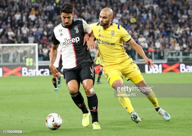 Sami Khedira of Juventus competes for the ball with Sofyan Amrabat of Hellas Verona during the Serie A match between Juventus and Hellas Verona at...