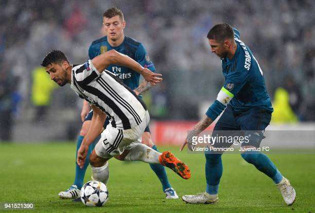 Sami Khedira of Juventus competes for the ball with Toni Kroos of Real Madrid during the UEFA Champions League Quarter Final Leg One match between...