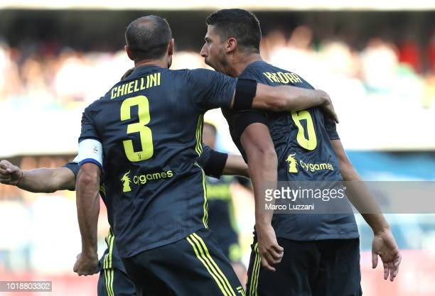 Sami Khedira of Juventus FC celebrates with his teammate Giorgio Chiellini after scoring the opening goal during the Serie A match between Chievo...