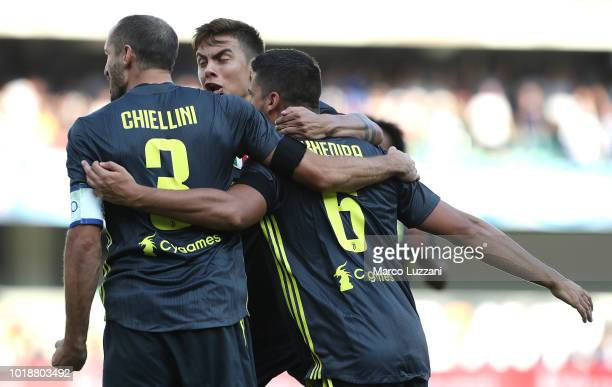 Sami Khedira of Juventus FC celebrates with his teammates Giorgio Chiellini and Paulo Dybala after scoring the opening goal during the Serie A match...