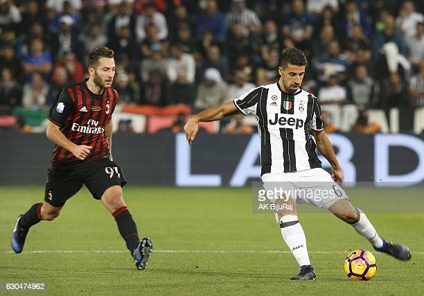 Sami Khedira of Juventus FC in action against Andrea Bertolacci of AC Milan during the Supercoppa TIM Doha 2016 match between Juventus FC and AC...