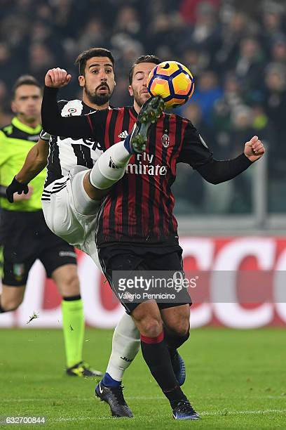 Sami Khedira of Juventus FC in action against Andrea Bertolacci of AC Milan during the TIM Cup match between Juventus FC and AC Milan at Juventus...