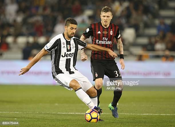 Sami Khedira of Juventus FC in action against Juraj Kucka of AC Milan during the Supercoppa TIM Doha 2016 match between Juventus FC and AC Milan at...