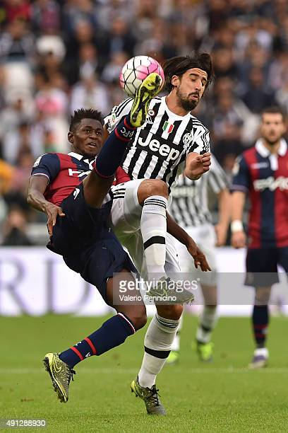 Sami Khedira of Juventus FC is challenged by Amadou Diawara of Bologna FC during the Serie A match between Juventus FC and Bologna FC at Juventus...