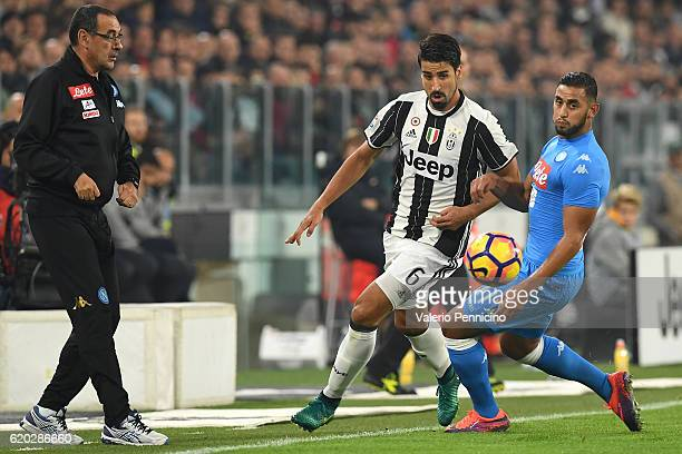 Sami Khedira of Juventus FC is challenged by Faouzi Ghoulam of SSC Napoli during the Serie A match between Juventus FC and SSC Napoli at Juventus...