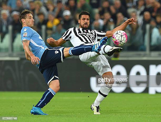 Sami Khedira of Juventus FC is challenged by Lucas Biglia of SS Lazio during the Serie A match between Juventus FC and SS Lazio at Juventus Arena on...