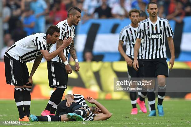 Sami Khedira of Juventus FC lies injured during the preseason friendly match between Olympique de Marseille and Juventus FC at Stade Velodrome on...