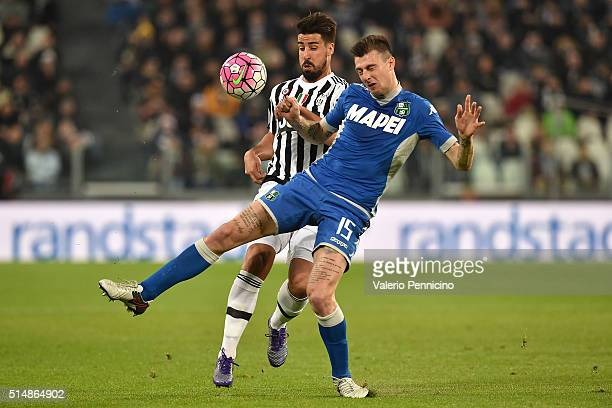 Sami Khedira of Juventus FC turns Francesco Acerbi of US Sassuolo Calcio during the Serie A match between Juventus FC and US Sassuolo Calcio at...
