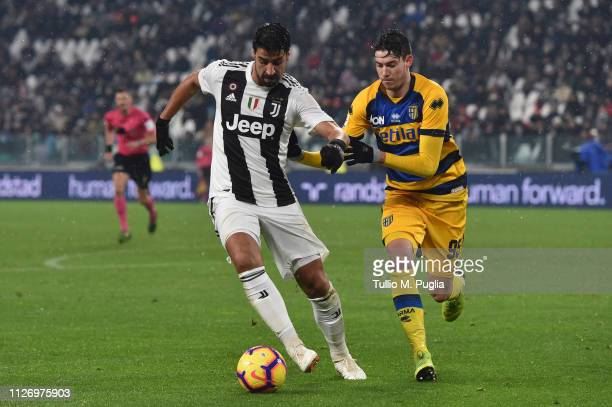 Sami Khedira of Juventus is challenged by Alessandro Bastioni of Parma during the Serie A match between Juventus and Parma Calcio at Allianz Stadium...