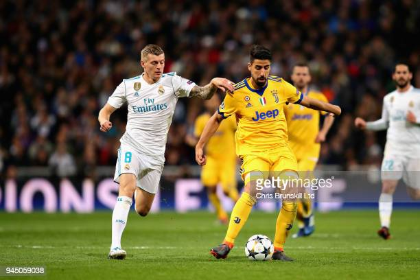 Sami Khedira of Juventus is challenged by Toni Kroos of Real Madrid during the UEFA Champions League Quarter Final second leg match between Real...