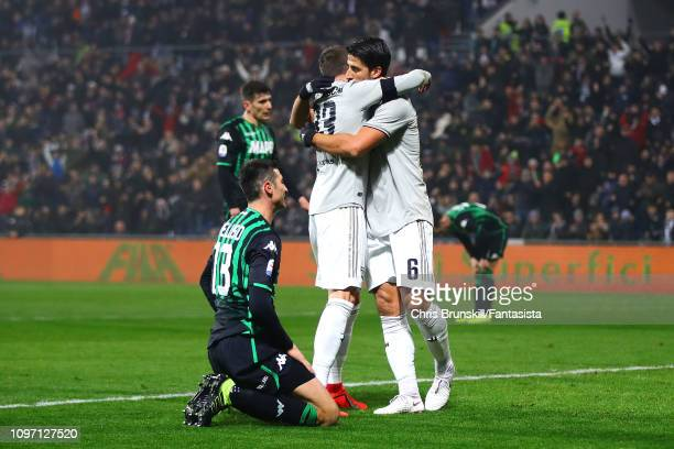 Sami Khedira of Juventus is congratulated by teammate Federico Bernadeschi after scoring the opening goal during the Serie A match between US...