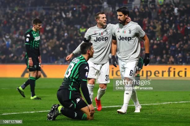 Sami Khedira of Juventus is congratulated by teammate Federico Bernadeschi after scoring the opening goal during the Serie A match between US...
