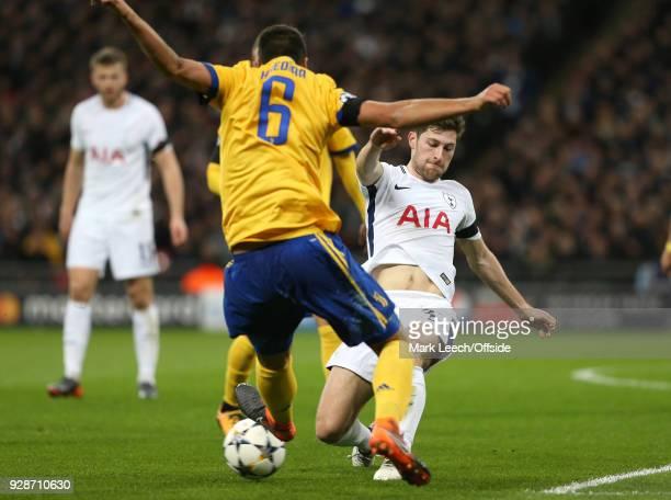 Sami Khedira of Juventus leaps to block Ben Davies of Tottenham during the UEFA Champions League Round of 16 Second Leg match between Tottenham...