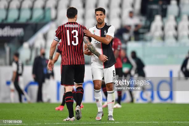 Sami Khedira of Juventus salutes Alessio Romagnoli of AC Milan at the end of the Coppa Italia Semi-Final Second Leg match between Juventus and AC...