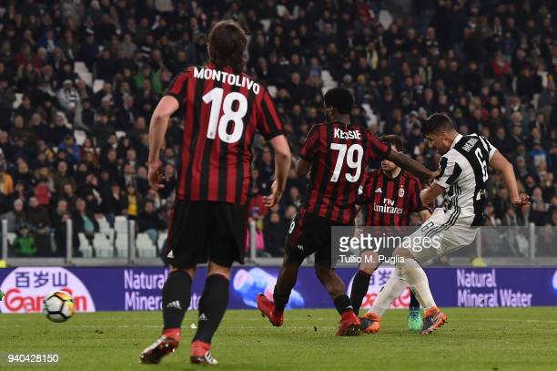 Sami Khedira of Juventus scores his team's second goal during the serie A match between Juventus and AC Milan at Allianz Stadium on March 31 2018 in...