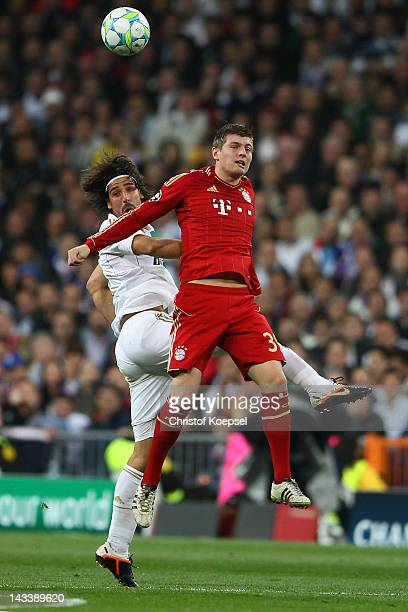 Sami Khedira of Real Madrid and Toni Kroos of Bayern go up for a header during the UEFA Champions League semi final second leg match between Real...