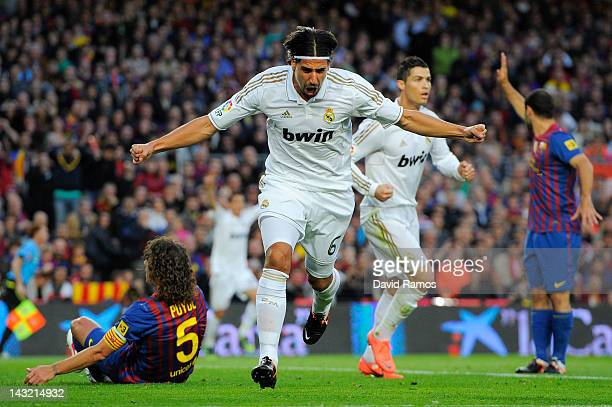 Sami Khedira of Real Madrid CF celebrates after scoring the opening goal during the La Liga match between FC Barcelona and Real Madrid at Camp Nou on...