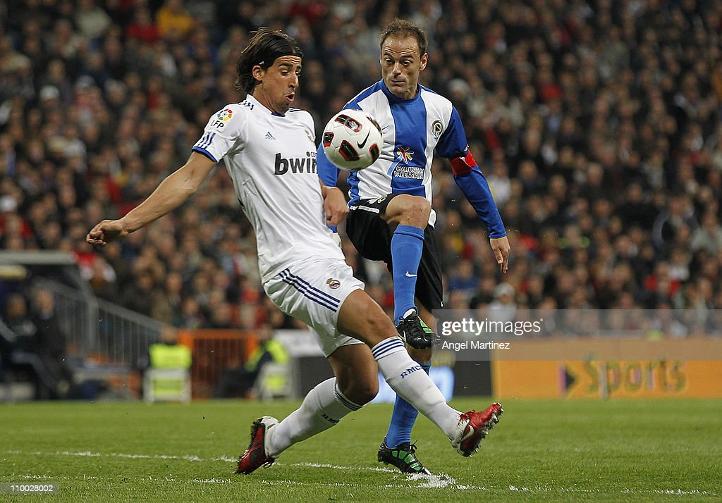 Sami Khedira of Real Madrid clashes with Francisco Farinos of Hercules during the La Liga match between Real Madrid and Hercules at Estadio Santiago Bernabeu on March 12, 2011 in Madrid, Spain.