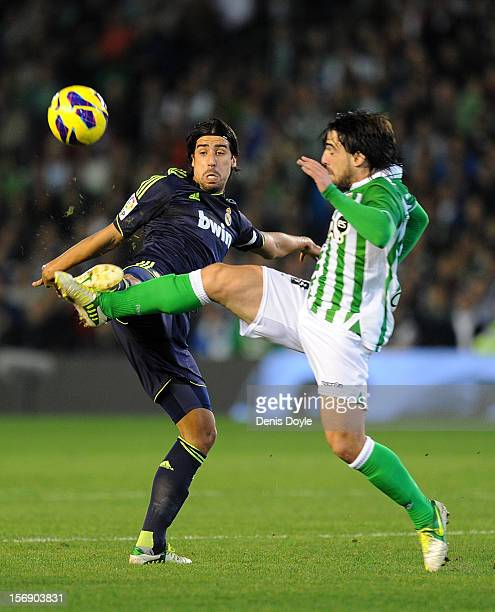 Sami Khedira of Real Madrid competes with Benat Etxeberria of Real Betis Balompie during the La Liga match between Real Betis Balompie and Real...