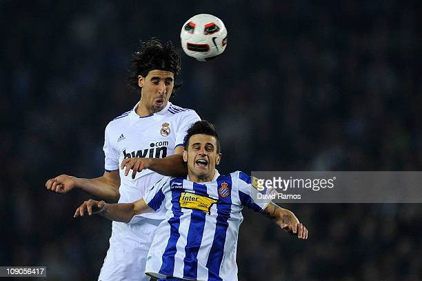 Sami Khedira of Real Madrid duels for a high ball against Javier Marquez of RCD Espanyol during La Liga match between RCD Espanyol and Real Madrid at...