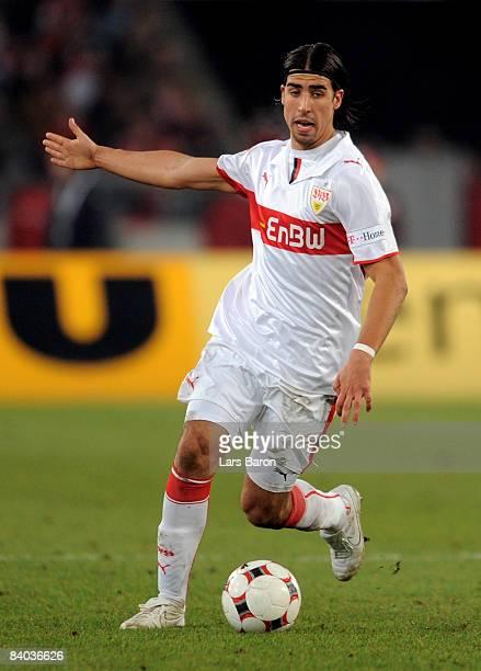 Sami Khedira of Stuttgart runs with the ball during the Bundesliga match between VfB Stuttgart and Bayern Muenchen at the MercedesBenz Arena on...