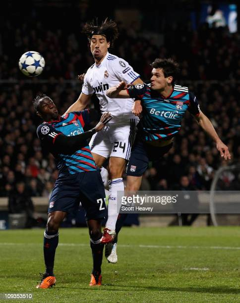 Sami Khedira Real Madrid in action with Aly Cissokho and Dejan Lovren of Lyon during the Champions League match between Lyon and Real Madrid at Stade...