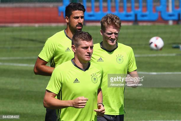 Sami Khedira Toni Kroos and Andre Schuerrle of Germany runs during a Germany training session ahead of their Euro 2016 quarter final match against...