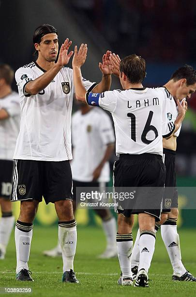 Sami Khedria and Philipp Lahm celebrate the 61 victory after the EURO 2012 Group A Qualifier match between Germany and Azerbaijan at RheinEnergie...