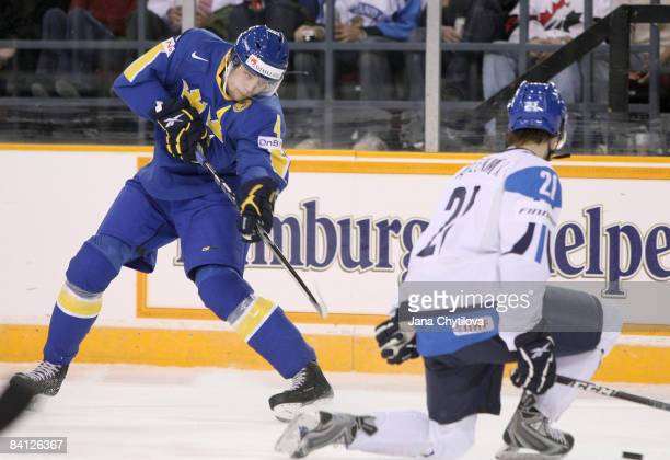Sami Lahteenmaki of Finland drops to one knee to block a shot from Victor Hedman of Sweden at the Civic Centre on December 26 2008 in Ottawa Ontario...