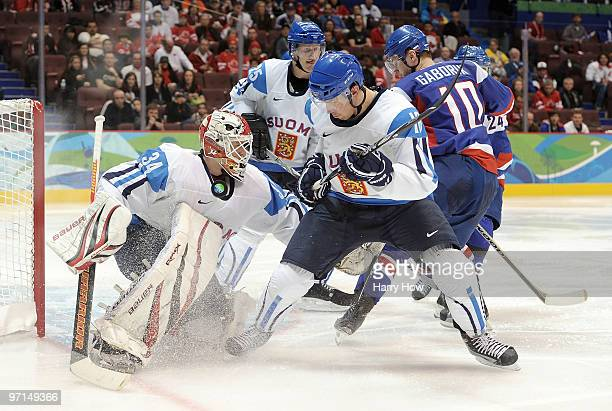 Sami Lepisto and goal keeper Miikka Kiprusoff of Finland in action during the ice hockey men's bronze medal game between Finland and Slovakia on day...