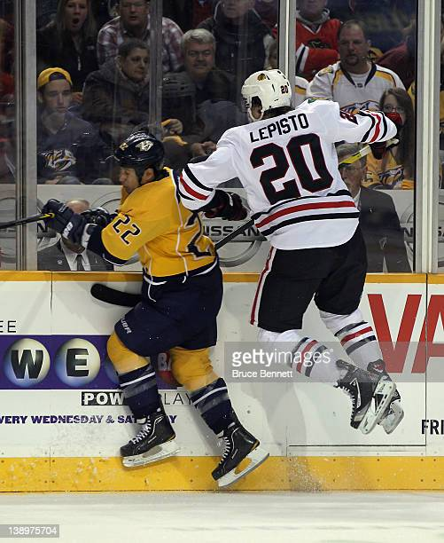 Sami Lepisto of the Chicago Blackhawks hits Jordin Tootoo of the Nashville Predators into the boards during the second period at the Bridgestone...
