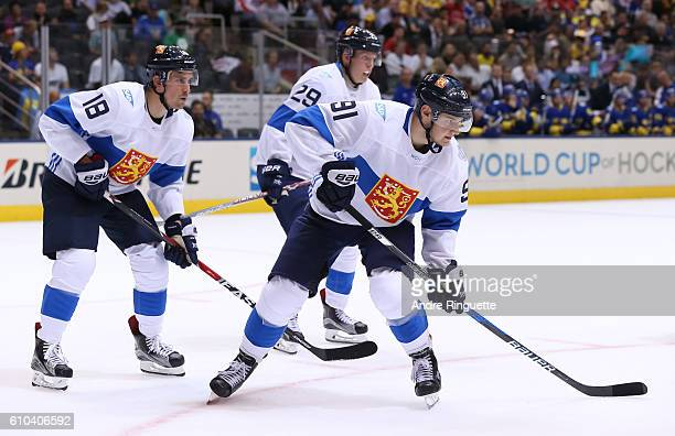Sami Lepisto Patrik Laine and Aleksander Barkov of Team Finland prepares for a faceoff against Team Sweden during the World Cup of Hockey 2016 at Air...