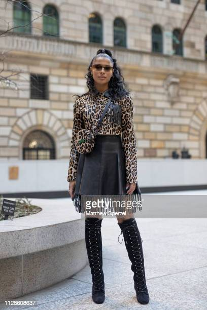 Sami Miro is seen on the street during New York Fashion Week AW19 wearing leopard print shirt and bag with black fringe leather skirt and kneehigh...