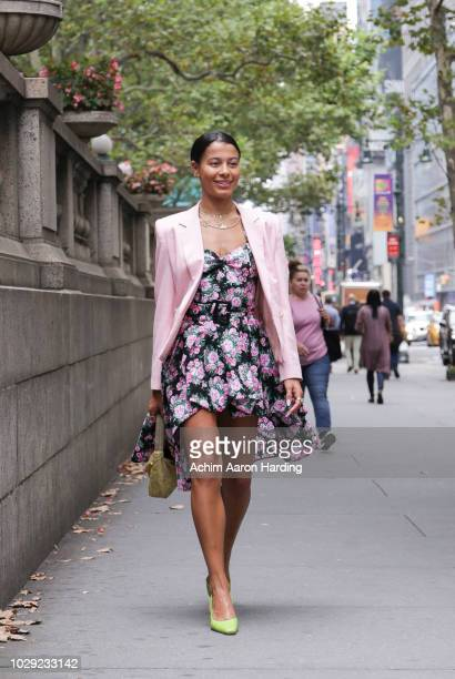 Sami Miro is seen wearing a pink blazer a floral dress and lime green Prada shoes on the street during New York Fashion Week on September 7 2018 in...